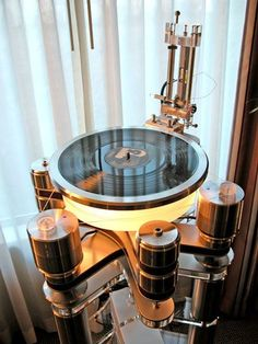 Clearaudio Maximum Solution turntable with Master TQ-I linear tracking tonearm (retracted into the vertical position for LP access). The stand is the imposing Clearaudio Everest structure, which integrates perfectly with the associated turntable