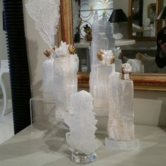 Decorated selenite on stands.