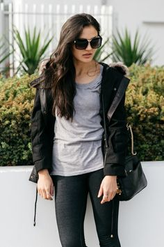 Try pairing a black toggle coat with black leggings for an easy to wear look.   Shop this look on Lookastic: https://lookastic.com/women/looks/black-duffle-coat-grey-crew-neck-t-shirt-black-leggings/14966   — Grey Crew-neck T-shirt  — Black Duffle Coat  — Black Leather Crossbody Bag  — Black Leggings