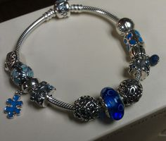 My new blue JIGSAW pandora charm arrived today.  Man do i love me a good charm <3