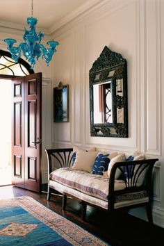 This entrance hall incorporates an Italian daybed, a Dutch mirror, a Persian rug and a Venetian chandelier, all from different time periods. Read more: http://www.oprah.com/home/Decorators-Biggest-Mistakes-Home-Decorating/6#ixzz1uzmpPZp8