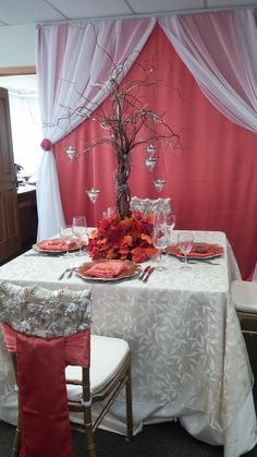 Orange backdrop using a tablecloth and chiffon panels tied back with sashes #yyceventrentals #fallwedding www.greateventsrentals.com