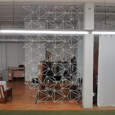 awesome, awesome DIY room divider -- made of simple wire hangers!! -- project and photo by @Mike Tucker Tucker Tucker Tucker McCaffrey