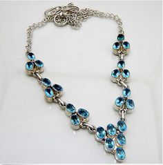 """Blue Topaz Quartz Gemstone Necklace Handmade Jewelry .925 Silver Plated  This artisan-made, statement, Blue Topaz gemstone necklace is sure to perfect finishing touch to any outfit. Several of gorgeous, marquise cut stones  all connected by silver chain. Modern & Elegant.   -Handmade, OOAK (one-of-a-kind) -18"""" length, silver chain, toggle clasp -Blue Topaz Quartz Gemstone  Handcrafted by highly skilled artisans who are trained to achieve perfection of every single gemstone jewel"""