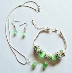 Green Cat Eye Beaded and Euro Set: Necklace, Bracelet and Earrings.    This set only has 2 more days. The current bid is over 5000 but as I am sure many of you know, the real bidding is done in the last few minutes!!