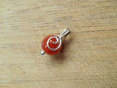 10mm Red Fire Agate Bead Wire Wrapped in Sterling by OurBackYard, $4.00