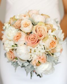 Hand held bouquet of sahara roses, peony roses, David Austin roses, stephanotis and Dusty miller. Image by Calli B Photography