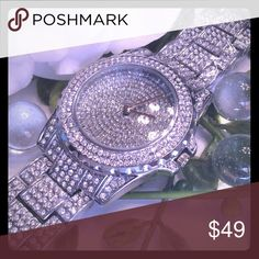 """STAINLESS STEEL RHINESTONE  QUARTZ WATCH 9"""" RHINESTONE STAINLESS STEEL QUARTZ WATCH. LINKS ARE EASILY TAKEN OUT TO MAKE SMALLER. GORGEOUS SHINE. NEW IN BAG. THE RHINESTONES HAS CLEAR WRAPPING ON THEM IN THE FIRST PICTURE TO PROTECT THE WATCH UNTIL YOU GET IT. boutique Jewelry"""