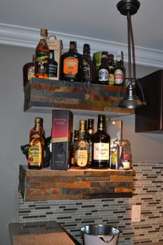 bar shelving ideas | floating bar shelves faced with stone | Stone craft ideas