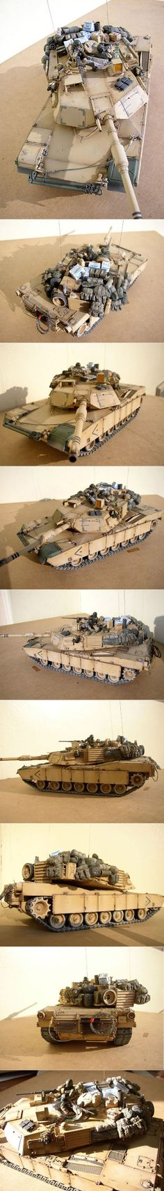M1A1 1/35 Scale Model.  Looks like this might be the Academy kit.  Outstanding job overall, really captures the look of a tank in combat.