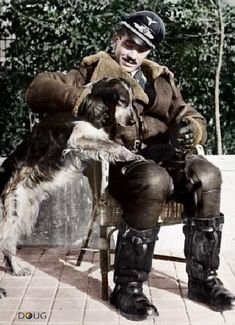 """meninroad: """"© IWM (HU Major Adolf Galland, the leading ace of the Luftwaffe during the Battle of Britain, seated in a chair with his dog. Luftwaffe, Adolf Galland, Photo Avion, Flying Ace, Man Of War, History Online, War Dogs, Battle Of Britain, Fighter Pilot"""