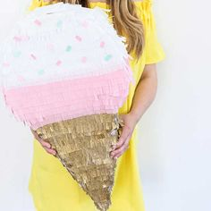 Looking for the perfect DIY project for summer fun? Why not add ice cream to the mix. This frilly piñata makes for fabulous party décor all summer long. Even better? It won't melt!