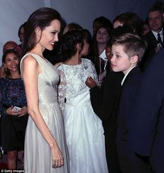 A mother's affection: Angelina couldn't hide her pride as she beamed brightly while she se...