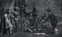 Mohawk Indians Trading at Fort Johnson : Fanciful  episode in the Fort Johnson Pageant of 1919, depicting a French trader showing his wares to a group of Mohawk Indians loitering about the baronial mansion of Sir William Johnson.