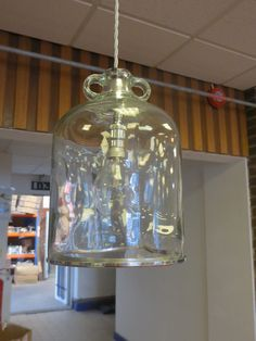 metro lighting recycled demi-john bottle converted for use as a pendant. we had to remove the base, polish the glass to remove sharp edges then we added a chrome trim to finish it off.Wired for BC lampholder using braided silver colour cable