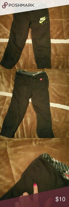 Nike jogging pants Dark grey Nike jogging pants. Good condition. Only flaw is where I pointed out a darker spot in the 3rd pic. Didn't know it was even there til I looked it over. Not noticeable. Great for the busy little boy for play. Nike Bottoms Sweatpants & Joggers