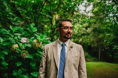 Groom in a beige linen suit for a destination wedding in spain- Sara Lazaro - A Rosa Clara dress for an outdoor wedding in Spain with a blue and yellow colour scheme and photography by Sara Lazaro