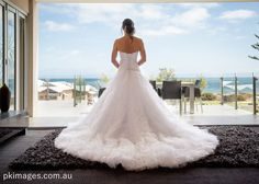 The bride preparation was at the Clarion Suites Mullaloo Beach. Back of the wedding dress.