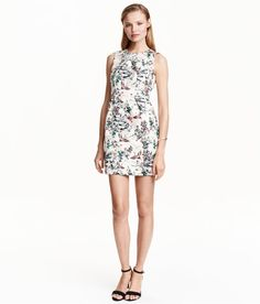 50 Sleeveless, fitted dress in jacquard-weave fabric with a sheen and a printed pattern. Wrapover neckline, seam at waist with pleats at front, and visible metal zip at back. Lined.