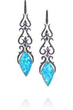 Stephen Webster's striking 18-karat white gold earrings are embellished with a glittering array of sapphires, blackened diamonds and black opalescent quartz. This exquisite pair is handmade in the label's London workshop. Black opalescent quartz, total weight: 22.03-carats; blue sapphires, total weight: 0.77-carats; pavé blackened diamonds, total weight: 0.63-carats
