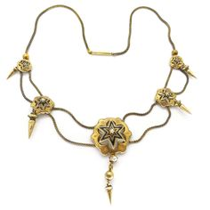 A stunning Victorian necklace on a pinchbeck gold base. The necklace features gold panels set with enamelled stars and pearls. The necklace is...