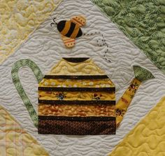 CLOSE-UP of a honey bee and a plant watering can on a quilt at the Dixon May Fair. This quilt is the work of Shirley Geertson of Vacaville. ...