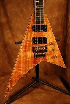 Jackson Randy Rhoads electric uitar - gorgous blond wood grain with Flying V style body - sort of. #cSw - 4 5 6 Strings - https://www.pinterest.com/claxtonw/4-5-6-strings/ - Pinned via Joel Woodin.