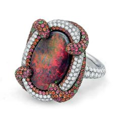 Australian Red Opal Ring by Martin Katz. The rarest of all colors of opal, surrounded by diamonds, held in a swirl of red and orange sapphires, tsavorites and green garnets. Red Jewelry, High Jewelry, Gemstone Jewelry, Diamond Jewelry, Bullet Jewelry, Diamond Brooch, Diamond Bangle, Gothic Jewelry, Black Opal Ring