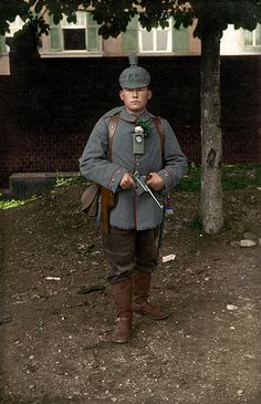 German; 65th (4th Wurttemberg) Field Artillery Regiment. Gunner. He holds a C96 Mauser and wears brown corduroy trousers. These trousers were only semi-official and came in various shades of grey, black & brown. This is a modern colourisation of an original photograph.