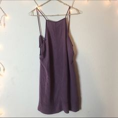 """Free People Lilac Purple Slip Dress Super gorgeous lilac/purple color. Flowy fit and very cute. Great for a size XS or S. Has cross crossed in the back and slightly open sides. Can be worn as a dress on anyone 5'8"""" and under. So pretty Free People Dresses Midi"""