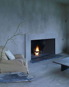 Fireplace surround with plaster walls