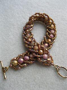 Flat spiral design reversible bracelet smoky by BeadALittleDream. Love the colors!