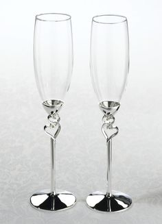 "Standing 10.5"" tall, this pair of toasting glasses offers a lovely heart detail on the stem. The stem and base are silver plated and tarnish-resistant."