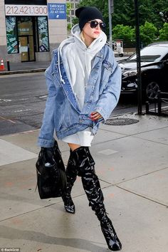Traffic stopping: Hailey Baldwin stepped out in thigh-high black patent leather boots in New York City on Friday