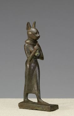 Statuette of a Standing Bastet · The Walters Art Museum · Works of Art Cats In Ancient Egypt, Ancient Egyptian Art, Ancient History, Art History, Objets Antiques, Statues, Egyptian Cats, Art Antique, Egyptian Goddess