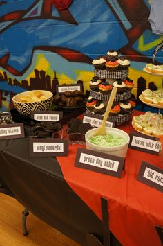 "Rock star themed food. ""Ringo star"" cupcakes, ""buns and roses"" jello ""green day"" salad and oreos for vinyl records"
