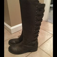Brown lace up riding boots. Worn one time. Brown lace up in the back riding boots. Worn only one. Carlos Santana Shoes Winter & Rain Boots