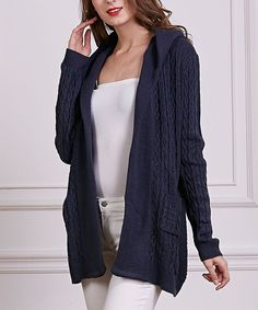 Navy Cable-Knit Wool-Blend Hooded Open Cardigan. . ..  Simply Couture. . ..  $24.99 Compare at $99.00  . size: size chart. S  . M  . L  .  Product Description:  Collections of layering essentials receive a cozy upgrade from this snuggly wool-blend cable-knit open cardigan complete with a simple to match hue.      45% wool / 40% polyester / 15% acrylic  .     Hand wash  .     Imported