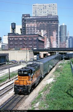 MILW a passenger handles switching chores near Chicago Union Station as afternoon rush hour approaches. The Geep is moving a group of commuter bi-level coaches and cab cars toward the station for outbound trains. Union Station, Train Station, Railroad Pictures, Milwaukee Road, Railroad Photography, Electric Train, Chicago Style, Train Journey, Diesel Locomotive