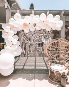 Boho shower with balloon arch and macrame.