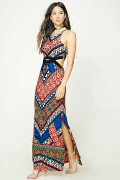 A knit maxi dress featuring a geo print, high neck, front and back cutouts, and side slits.
