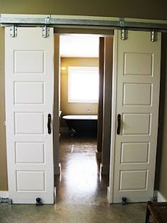 Sliding Doors Like This Barn Door Allow Rooms To Be Hidden. Decorating: Nice Bypass Sliding Barn Door Hardware For . Home and Family Interior Barn Door Hardware, Interior Sliding Barn Doors, Bed Hardware, Barn Door Closet, Diy Barn Door, Double Sliding Barn Doors, Barn Door Handles, Barn Door Designs, Bathroom Doors