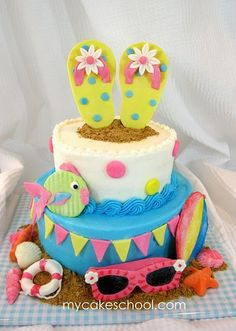 Summer beach cake for birthday parties ~ girly beach theme cake ~ flip flops, sunglasses, fish, beach ~ love it!