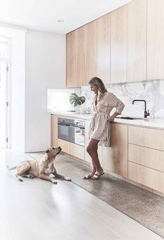 Kitchen: Louisa with her dog Sim. The polished concrete floor was part of the original house and fits in with the updates, and the original spotted gum flooring was sanded, limewashed and revived by Mint Floor Sanding & Finishing. Modern Kitchen Renovation, Home Renovation, Kitchen Remodelling, Contemporary Kitchen Design, Interior Design Kitchen, Kitchen Designs, Spotted Gum Flooring, Kitchen Benchtops, Kitchen Splashback Ideas