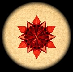 This one is folded from red glassine. There is an inner star here that is barely visible in the previous one due to the translucence of the glassine. A Dennis Walker design.