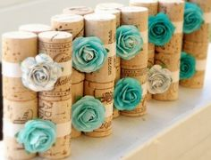 k i thought these were awesome and super easy to make! just use corks and hot glue and the can be used as the place setter holder, throw in a wire in the center to hold the number of hte table or the name of the number
