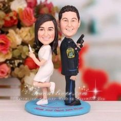 Police Officer and Nurse Wedding Cake Toppers ... completely customizable to look like the couple! how cool?!