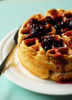 Cheesecake Stuffed Waffles with Berry Syrup from A Duck's Oven. Fluffy Belgian waffles stuffed with cheesecake filling and topped with berry syrup. The brunch to end all brunches!