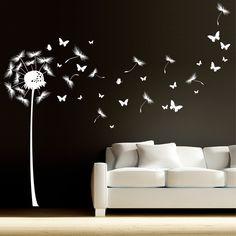 Pusteblume mit vielen Schmetterlingen