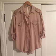 Ever Nude/Beige Sheer Utility-Style Blouse Ever light nude/beige sheer utility-style blouse. High-end avant-garde brand, similar to All Saints. Slightly dolman sleeves that can be cuffed/rolled up, and buttoned. Straps attach to button along entire outer arm to shoulder. Collar. Hidden chrome-tone button placket. Two chest pockets. Unique seaming. Harder to find style and brand! Great condition; a few loose threads and missing top button which is not seen and usually wouldn't be buttoned…